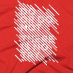Red tshirt close up with white graphic